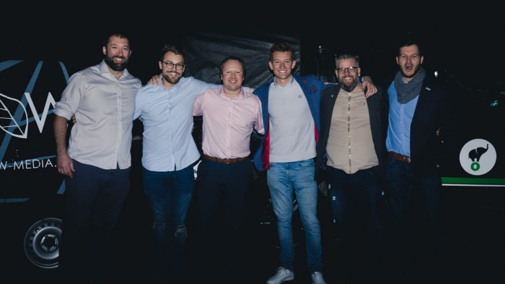 Employees of Lightfoot and Grow stand arm in arm launch party of Breathe Exeter