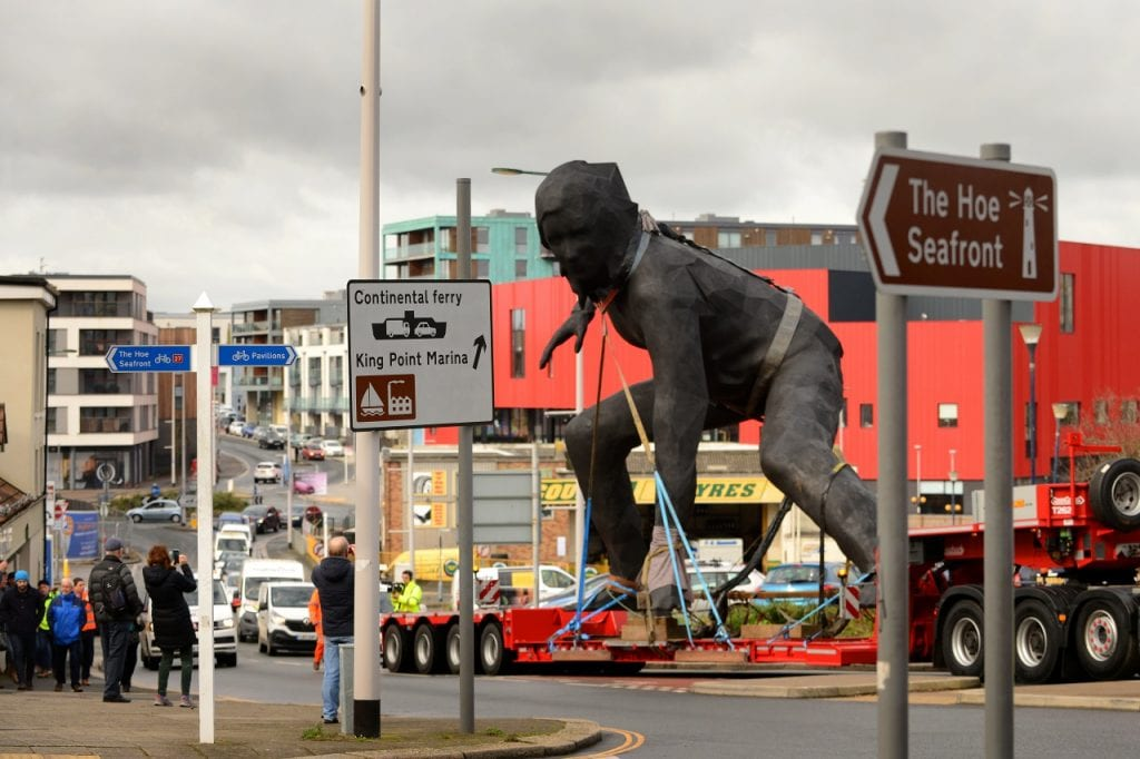 bronze sculpture Messenger on back of lorry transported through Plymouth