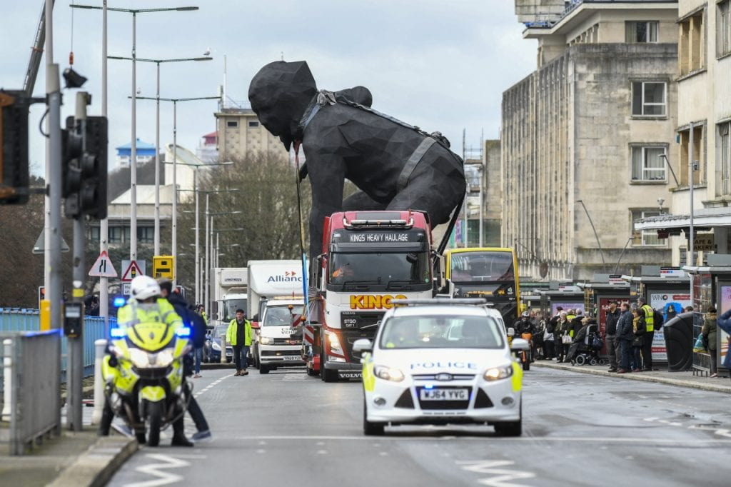 bronze Messenger sculpture on lorry given a police escort through Plymouth