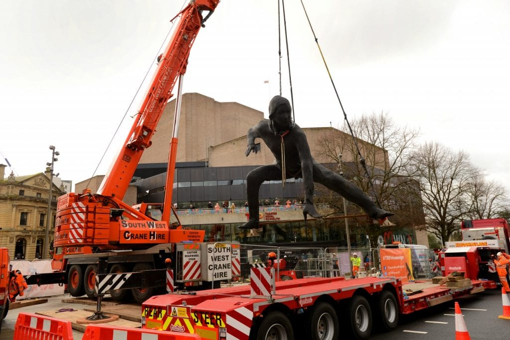 bronze sculpture Messenger being craned outside Theatre Royal Plymouth