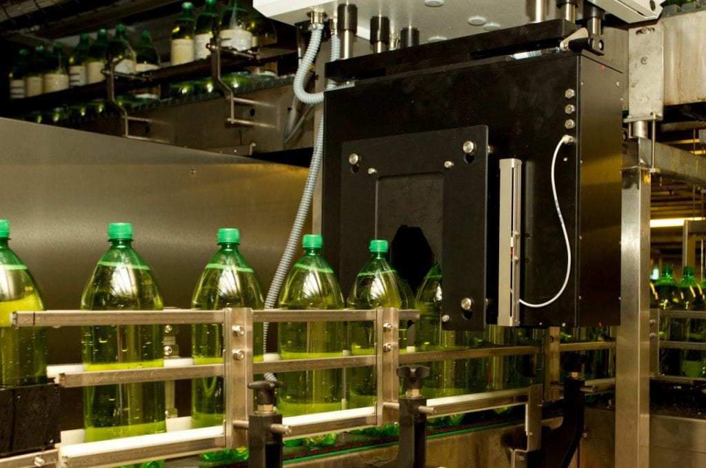 Plastic bottles on factory production line at Aston Manor Cider works
