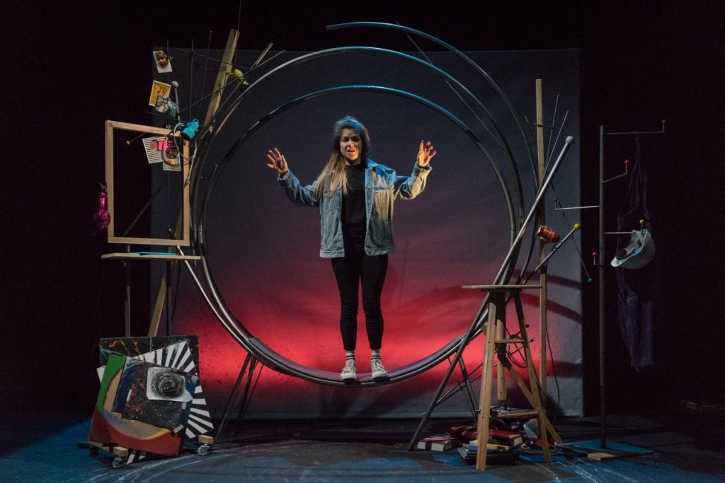 Anna Wheatley stands inside the free standing circle on stage at Falling by Theatre Alibi