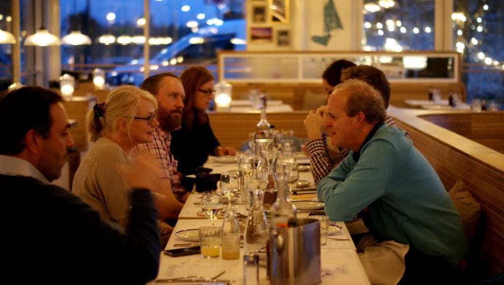 Diners sit at a long table at the new Rockfish Exeter