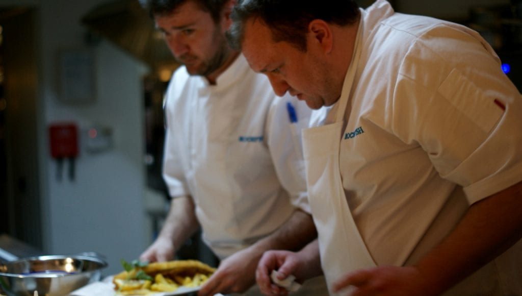 Chefs preparing fish and chips in the new Rockfish Exeter