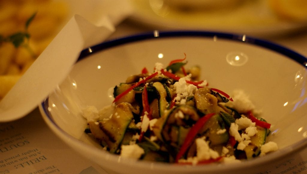 Bowl of chargrilled courgette salad with mint, feta and chilli