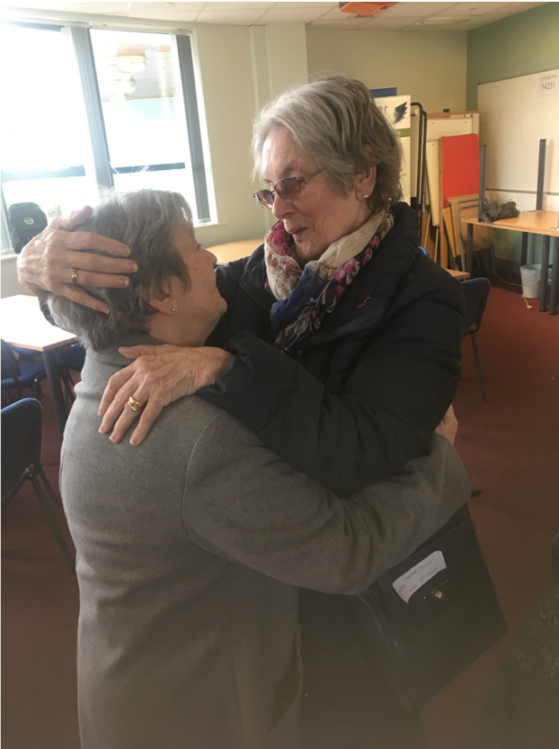 Two elderly friends hug after seeing each other for first time in 40 years.