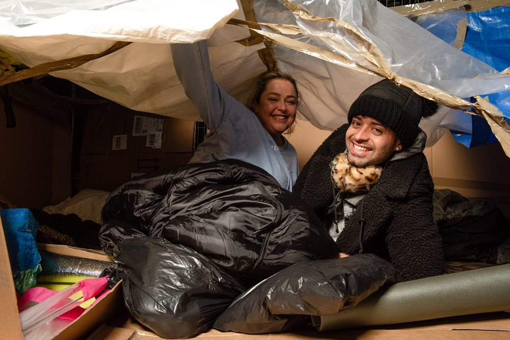 Lisa Butt and David Fosburry in home made shelter for YMCA EXeter Sleep Easy
