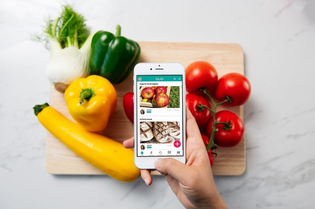 OLIO food sharing revolution APP on iPhone photographing vegetables