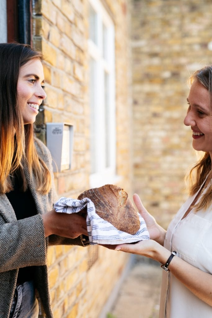 Two women use OLIO to share unwanted bread