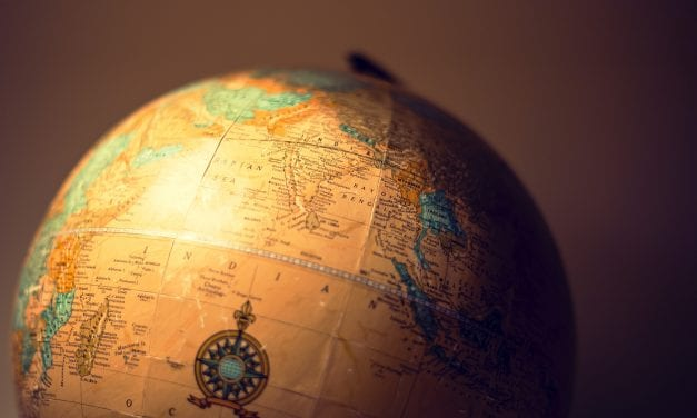 The Best of Both Worlds: A Local Adviser with a Global Support Network
