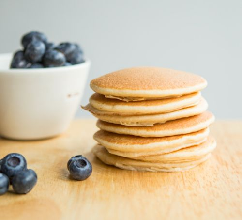 stack of wholemeal pancakes with blueberries