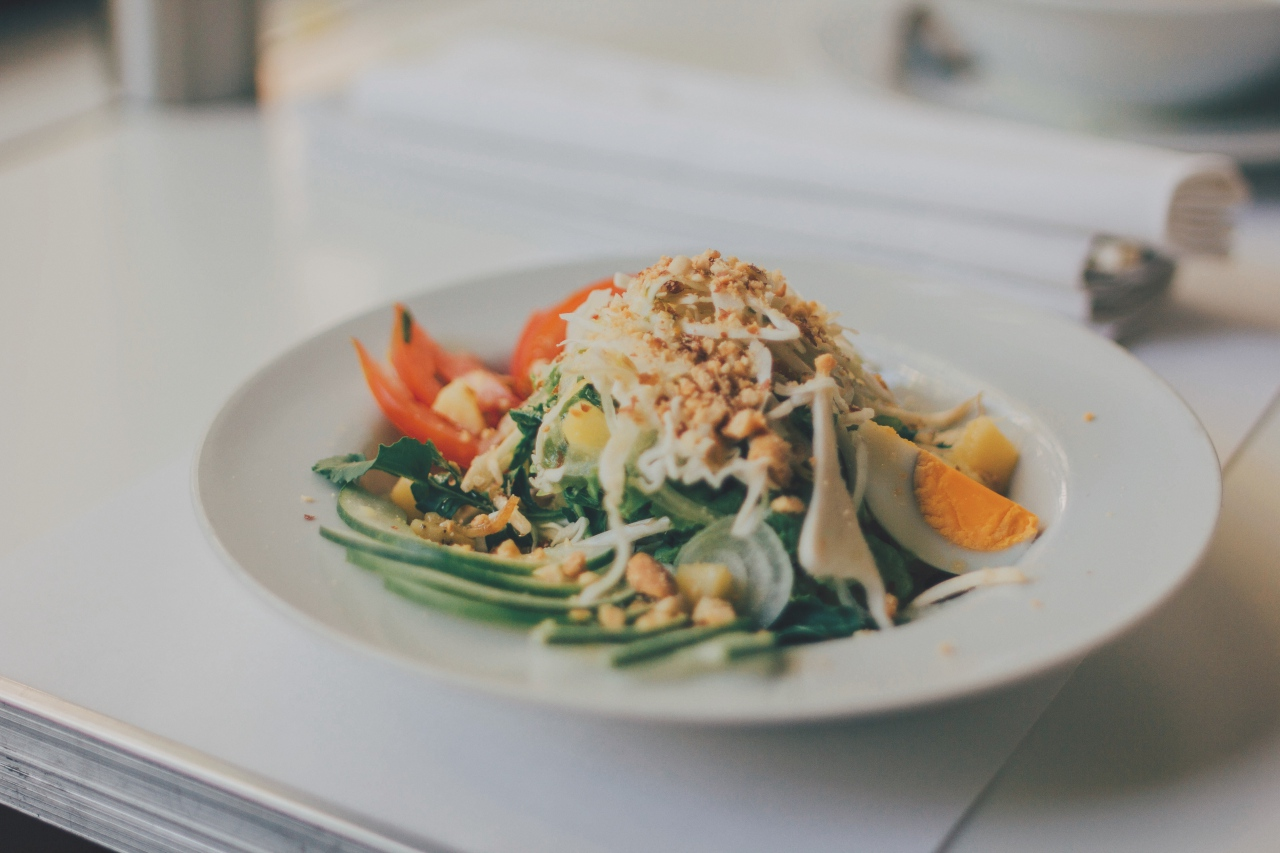 healthy plate of food topped with crushed peanuts