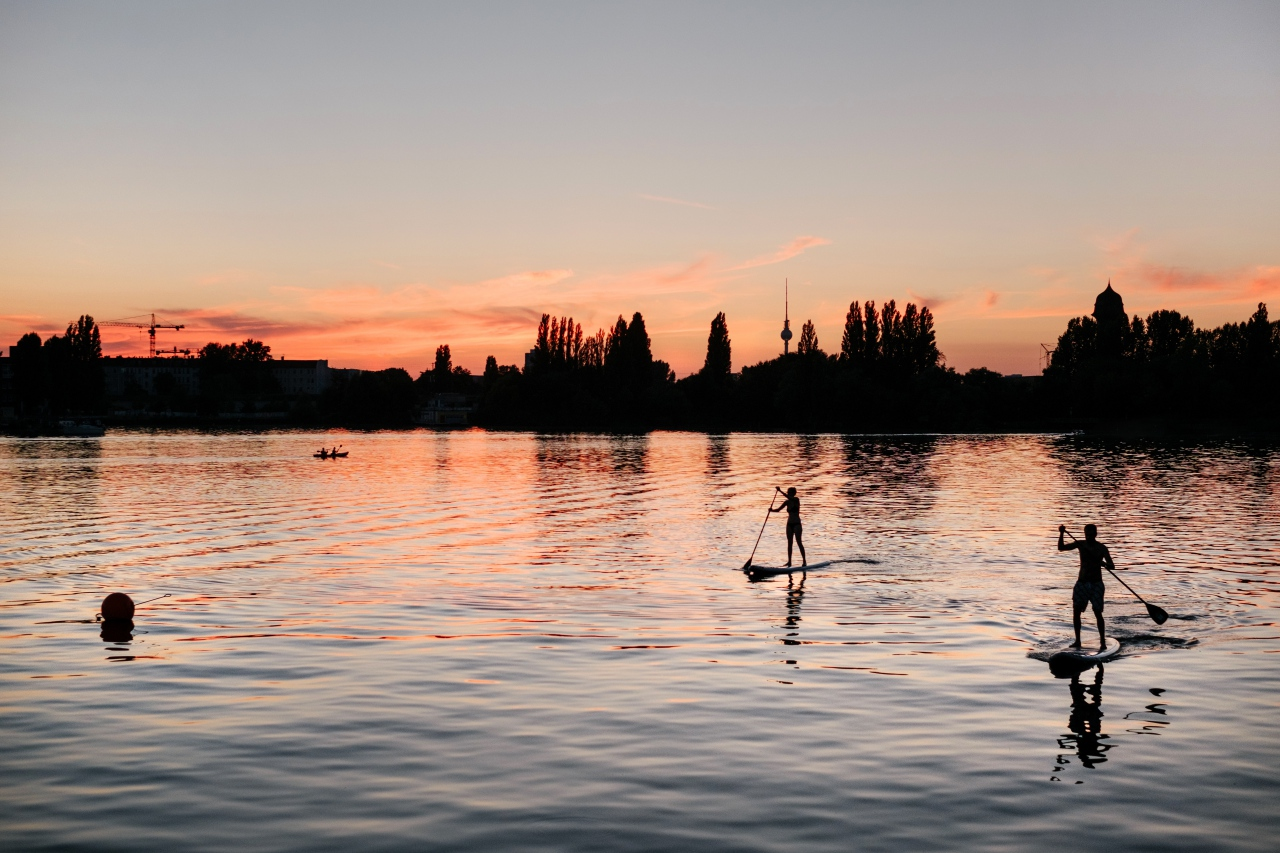 Live for Adventure paddleboarding at sunset.