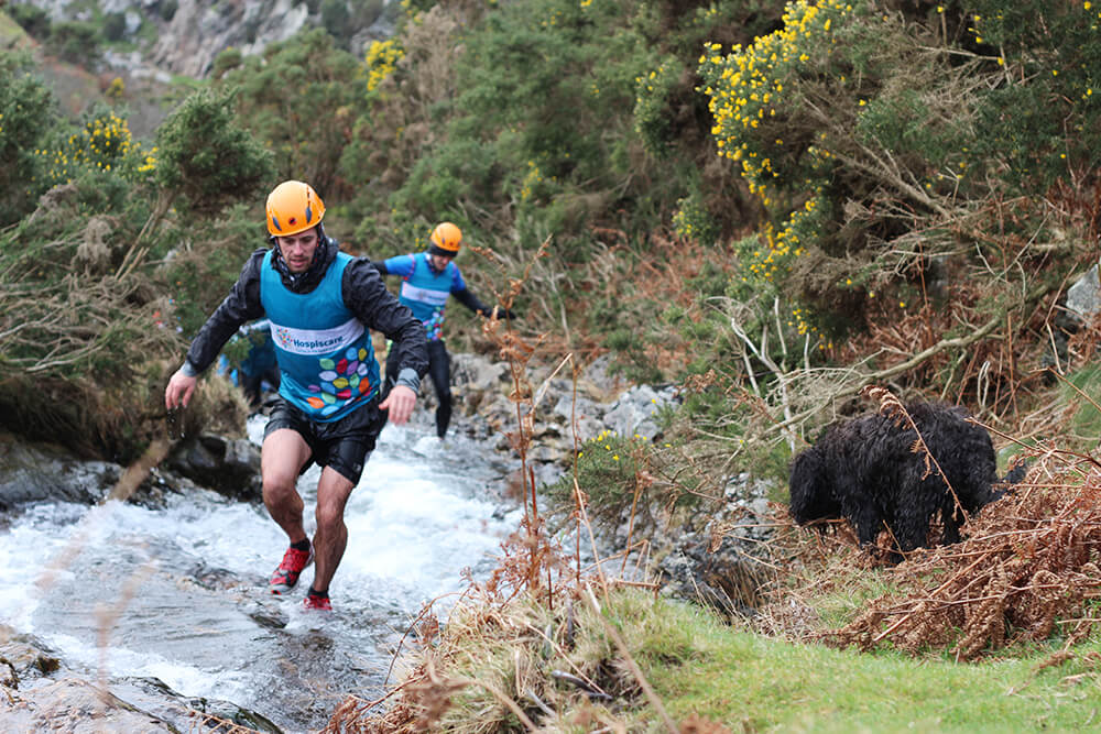 Two people doing the gorge scramble on Dartmoor for Wild Tri.