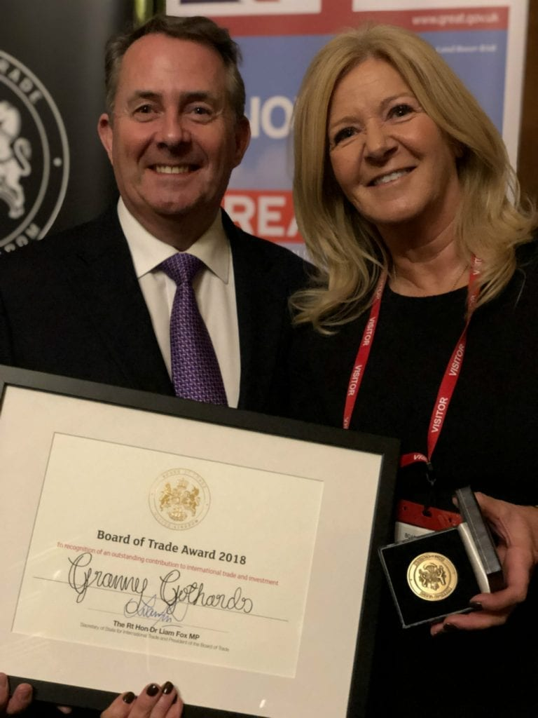 Amanda Stansfield holding a certificate and award for Granny Gothards Ice cream.