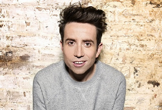 Nick Grimshaw smiles at the camera.