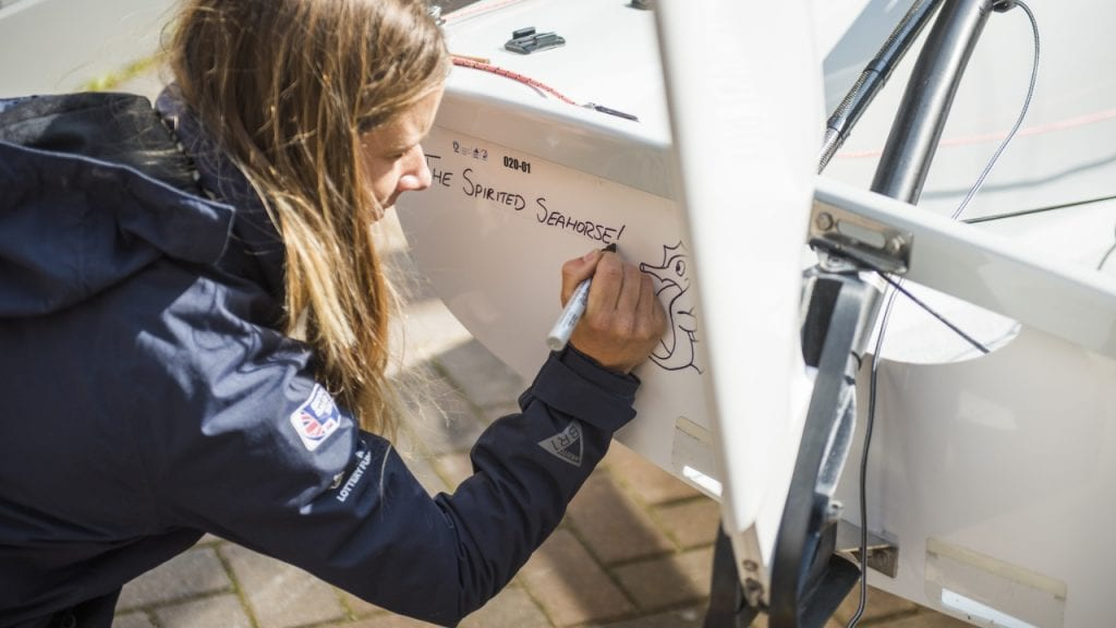 Hannahn Mills christens her sail boat the Spirited Seahorse first sustainability partner