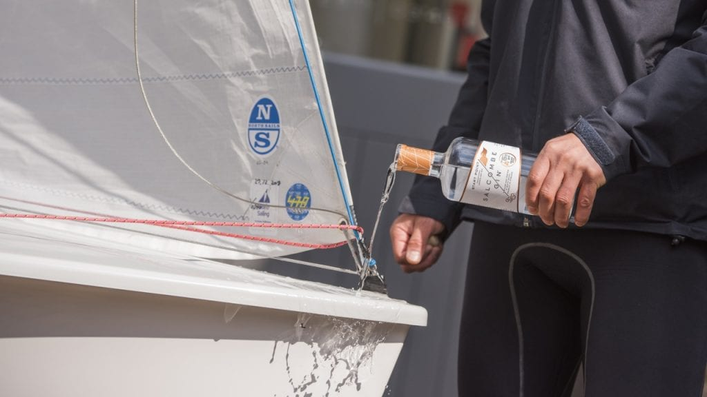 Sailboat being christened with Salcombe gin first sustainability partner