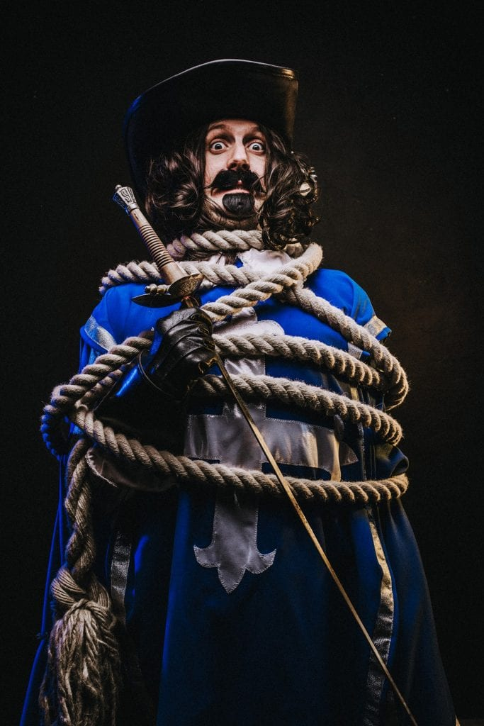 Dan Bianchi in Le Navet Bete's The Three Musketeers tied up in rope.