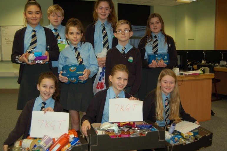 West Exe School students hold donations for Exeter Foodbank.