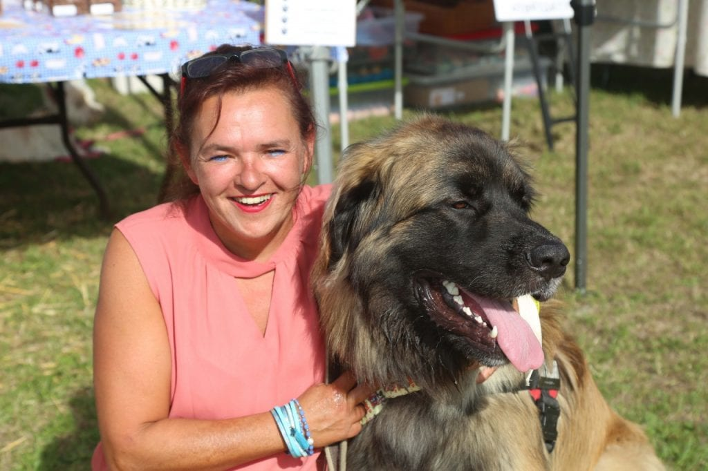 A woman with her dog at Woofstock UK 2019.