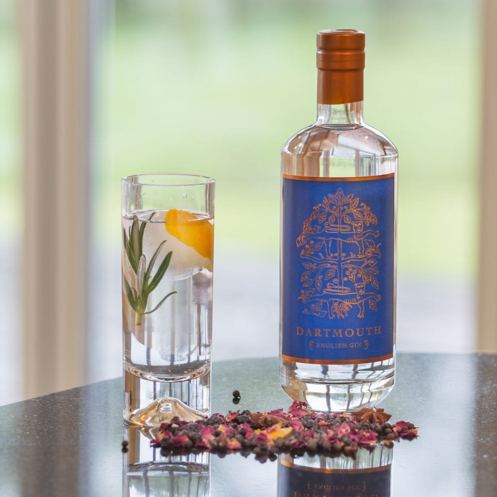 A bottle and glass of Dartmouth English Gin made by Lance Whitehead.