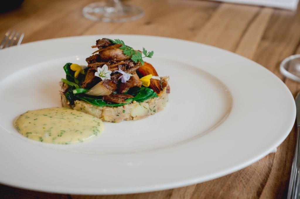 Rabbit Hash seasoned with Mustard and Tarragon and served with a Cider Béarnaise Sauce.