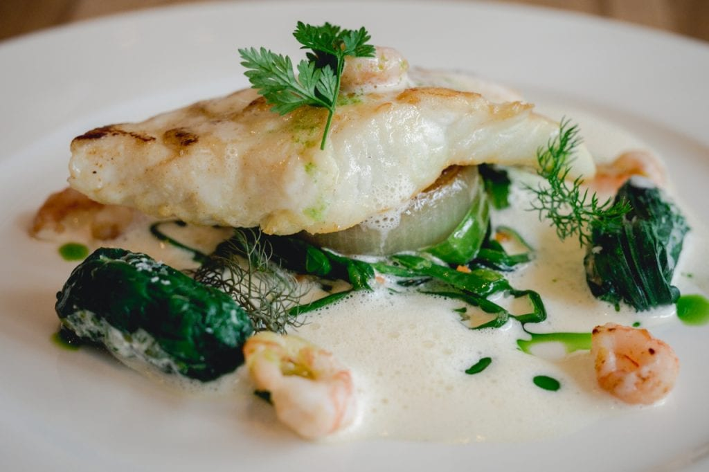 Ling white fish and green vegetables at Gather Totnes