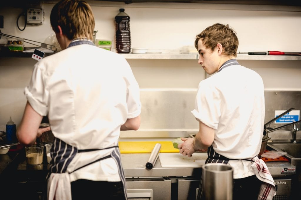 Two young chefs in the kitchen at Gather Totnes