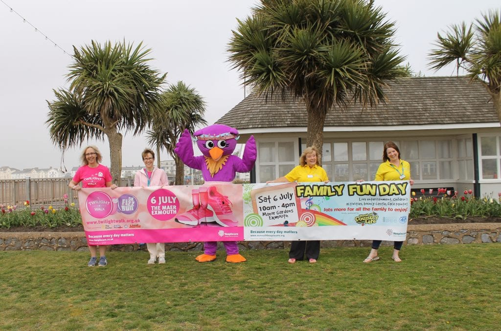 Hospiscare's 2019 Twilight walk banner held by volunteers and a giant pink bird.