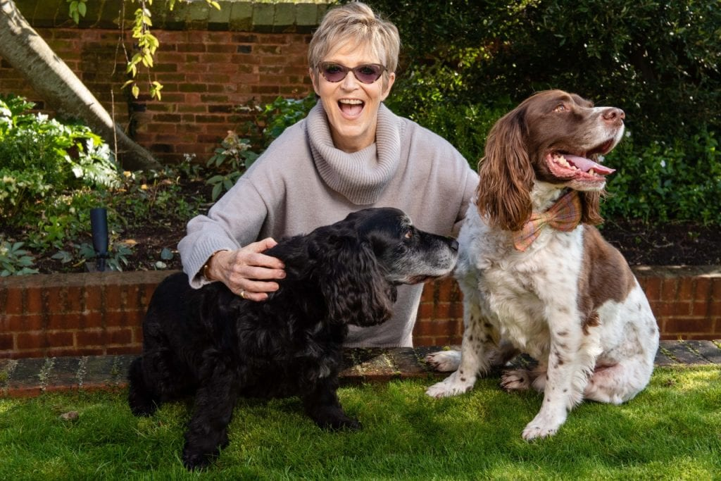 Judi Spiers with two dogs at Woofstock UK 2019.