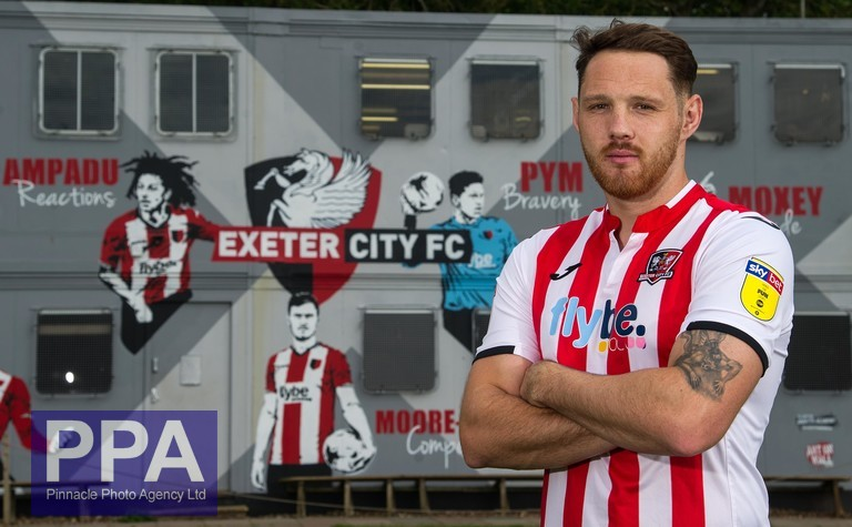Exeter City new signing, Tom Parkes poses during a photo call at Exeter City's Cliff Hill Training Ground on May 24, 2019 in Exeter, Devon England