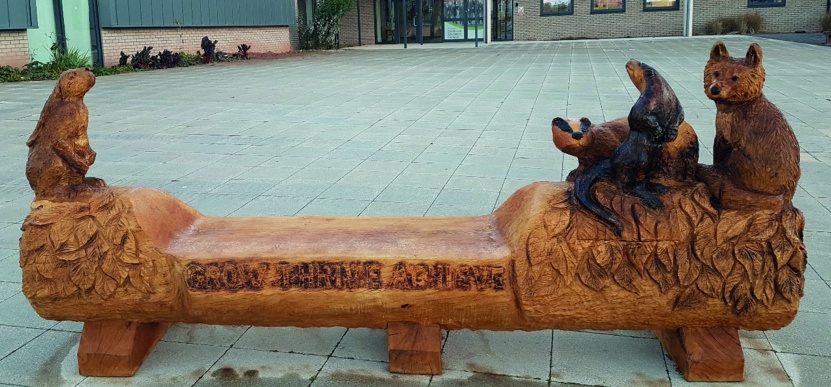 A wooden bench with four sculpted animals.