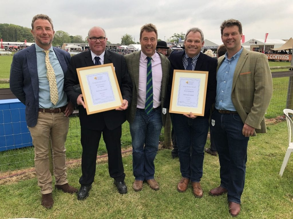 five men wearing suits stood holding award Darts Farm farmers