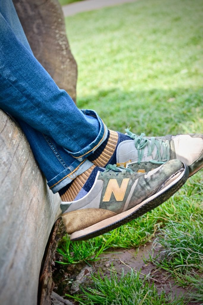 shoes feet jeans crossed grass
