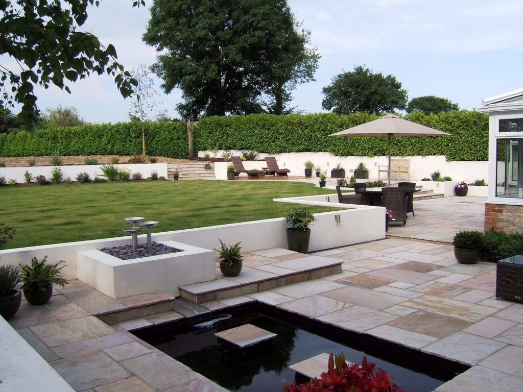 ever growing garden paving pond hedge trees