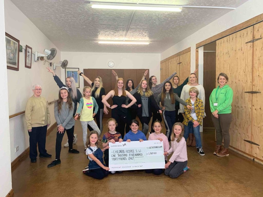 group of children presenting large cheque